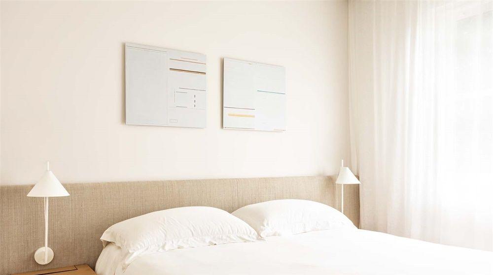 a文案的文案!里约热内卢Leblon木质阳光设计书籍装帧设计公寓图片