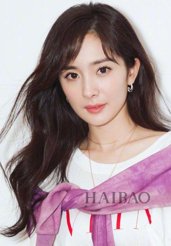 杨幂 发型 baby最近的造型和杨幂的 卷发 刘海 有些类似,不过她的发色图片